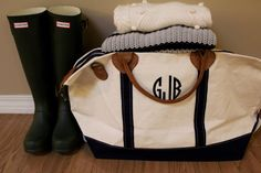 Hunter boots and monogram Tuckernuck bag via With Style and a Little Grace
