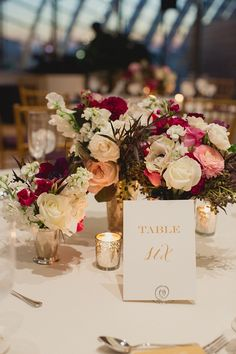 Centerpiece + Table Numbers | Elegant Wedding | See more on Style Me Pretty: http://www.StyleMePretty.com/mid-atlantic-weddings/2014/03/13/gold-sparkly-kimmel-center-wedding/ Lauren Fair Photography
