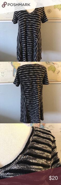 BLACK & WHITE Very J Tunic Dress Very J brand. Thick and heavy fabric, warm enough for winter! Could fit like a dress on some but I have a long torso so I wore it as a tunic. In excellent condition. Let me know if you have any questions! Sorry, no trades. Very J Tops Tunics