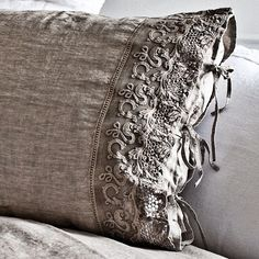 Linen and lovely edging. Love slip covered pillows.