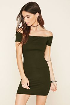 A ribbed knit bodycon dress featuring off-the-shoulder short sleeves and an elasticized neckline.