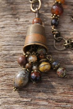 Love the colors of the beads and the vintage thimble