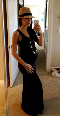 black maxi + fedora . If I'm ever preggo again I'm going to Rock this look. For sure