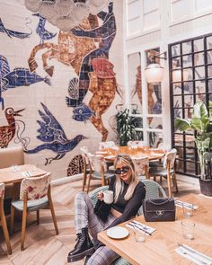 Image may contain: 1 person, sitting, table and indoor New York Winter Outfit, Ny Food, Art Restaurant, Instagram Wall, New York City Travel, Nyc Restaurants, Love Is All, Wall Colors, Wall Sticker