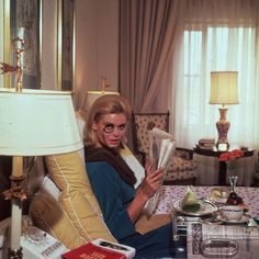 Renata Boeck enjoying breakfast in bed at the Regency Hotel in New York, 1964 by Slim Aarons.