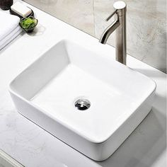 "Ufaucet Modern Porcelain Above Counter White Ceramic Bathroom Vessel Sink  Sleek European inspired modern contemporary design,Product Size 19 1/8"" x 14 3/4"" x 5 1/4""  Above the counter installation, Fit 1-3/4"" Center Drain Hole.  Premium quality ceramic construction,Smooth Ceramic: Easy to maintain and clean  Constructed of vitreous china: glazed and double fired for durability and stain resistance"
