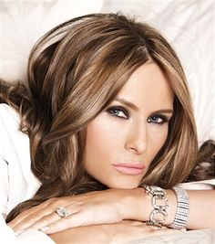Melania Trump poses for a portrait on April 14, 2010 in New York City. Melania Trump is wearing a shirt by Dolce & Gabbana, Champs-Elysees watch in silver by Melania Timepieces & Jewelry - Silvertone Crystal, encrusted link bracelet by Melania Timepieces & Jewelry, Silverstone eternity band ring by Melania Timepieces & Jewelry, makeup by Mykel Renner for Kett Cosmetics and hair by Mordechai for yarokhair.com.