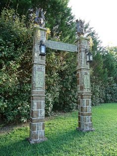 Evil Soul Studios Resurrection Cemetery Entrance Archway Haunted House Prop The archway appears to be hand carved out of stone. The columns on either side features EST 1904 plaques, hanging moss, metal scroll work hangers & black lanterns for holding tea lights or flicker flame candles.