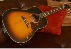 Wonderful Gibson J-160 E  hanging on the couch just waiting for you to start strumming!