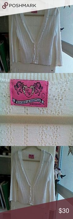 Sweet and Sinful cardigan Cute white 100% acrylic ruffled cardigan. Excellent condition Sweaters Cardigans