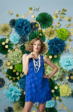 Using a cluster of paper flowers creates an amazing backdrop