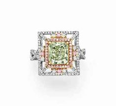 A COLORED DIAMOND AND DIAMOND RING  Set with a cut-cornered modified rectangular-cut fancy gray-yellowish green diamond in a surround of pink and white diamonds, set in 18kt yellow, rose and white gold.  Via Christie's; sale price $47,500.