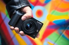 LUMIX GX80/GX85, black: Image Courtesy of Panasonic. Panasonic: Mirrorless Interchangeable Lens Compact Camera LUMIX DMC-GX85: 4K Video, 4K PHOTO, New 5-Axis Dual I.S. (Image Stabilizer) for Blur-Free Photo/Video Shooting in Low Light, Ultra-Fast Auto Focusing of Approx. 0.07 Sec, 16.0-MP Digital Live MOS Sensor without a Low Pass Filter, DFD (Depth From Defocus) Technology, L.Monochrome Mode in Photo Style, Focus Bracket & Aperture Bracket