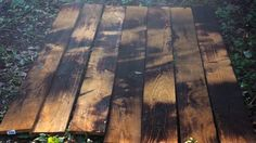 After you have a nice range of color and texture, use a wet sponge to cool and clean the wood. (This will also help prevent chars from becoming airborne.) With your face mask and protective gear on, use a wire brush to get rid of excess soot. Go over the boards one last time with a cloth to make sure they are thoroughly cleaned.