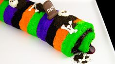 Halloween cake roll recipe.  Learn how to make a Halloween cake roll from scratch in this fun and colorful cake roll tutorial.