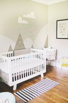 The neutral hues in this nursery are easy on the eyes. Love the simple, pleasant functionality! http://www.remodelaholic.com/2014/03/25-great-nurseries/nggallery/image/gray-nursery-with-mountain-mural-and-clouds/