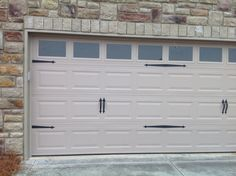 Sandstone Garage Door With Hardware And Stone Accent On This JSJ Builders  Home