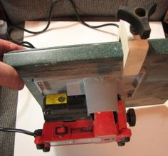 Mini Table Saw - Homemade mini table saw intended for modeling purposes. Adapted from a mini circular saw with a kerf blade, a 12x12 piece of Corian, and a wooden fence utilizing a threaded plastic knob as a locking mechanism.