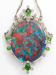 Black opal, diamond, and demantoid garnet pendant mounted in platinum. American, 1925.
