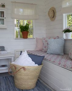 Sweet spring & summer sitting and reading porch. So lovely.