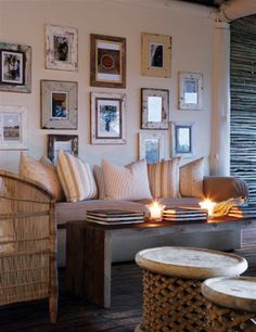 South African Bush Lodge Decoration. love the photo frames.