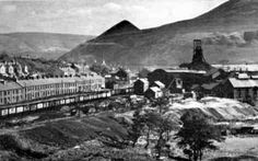 South Wales mining valleyAn old photograph of a South Wales mining valley. Note the pit head to the right and the typical terraced housing.