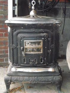 Air Tight Model 24 Woodburning Stove @ Ebay US $500.00 in Antiques, Home & Hearth, Stoves