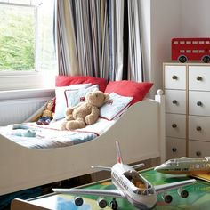 Practical furniture is ideal for storing away toys and getting rid of clutter. Here, underbed storage is great for day-to-day tidying.