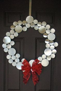 use metal or what i would use would be circular mirrors to add pizazz  change the ribbon for a more contemporary style and this would look great  on the door ...