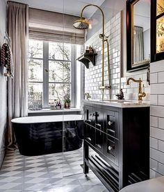 Going for the classy look with subway tile and black cabinets with metallic accents. Love this! #bathroom #homedecor @istandarddesign
