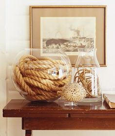 DIY Easy Beach House Decor - Rope in glass vase. Just throw some rope in a vase and you have instant beach house decor. Beach house decoration ideas and beach house decor at its finest. Coastal Homes, Coastal Decor, Seaside Decor, Coastal Colors, Seaside Theme, Beach House Decor, Diy Home Decor, Nautical Centerpiece, Centerpiece Ideas