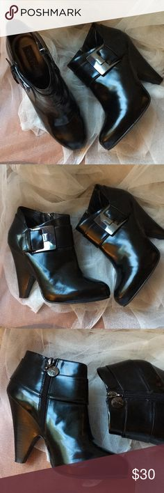 Vince Camuto Black bootie boots size 7 Preloved black bootie boots by Vince Camuto. SiZe 7 Vince Camuto Shoes Ankle Boots & Booties