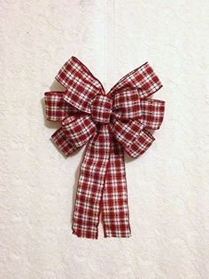 Christmas Gingham Checkered Wreath Bow Large. The Red & White Christmas Gingham Checkered Bow has been hand formed from a lovely 2.5 inch (6 cm) wired red & white cloth checkered plaid ribbon with green stitching detail throughout. This charming holiday bow is perfect for your indoor or outdoor holiday wreath decorating and looks great hung with garlands, swags, or displayed on your mantle or stairway. It is the larger size of wreath/accent bows I make. It has been sized to best fit your...