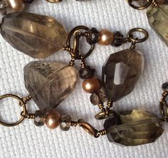 A personal favorite from my Etsy shop https://www.etsy.com/listing/573096315/smokey-quartz-and-pearl-elegance