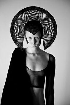 Morose-looking Black Queen in a semicircular headress/crown (Federico Cabrera)