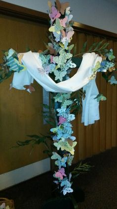 2014 Easter Sunday  |  During the service paper butterflies signifying the resurrection of Christ were placed onto a chicken wire covered cross using bobby pins.