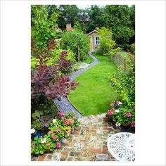 garden layout Narrow backyard visually enlarged by angled patio, sinuous lawn, path with a