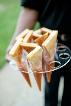 mini grilled cheese sandwiches and tomato soup. Fun presentation.
