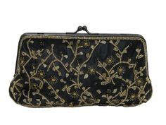 80s -Lancome- Womens black polyester satin and metallic gold and black polyester brocade with woven-in small leaves pattern, iridescent gold and brown seed beads in floral and tendrils design on front, satin on back and lining, trapazoid-shaped beaded convertible cocktail purse or handbag has a cord shoulder strap hidden inside or use it as a clutch, black metal frame with ball clasp (a few fine scratches on metal frame)
