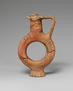 Terracotta flask with ring-shaped body, 850-600 BCE. Cypriot, Cypro-Geometric III - Cypro-Archaic I.
