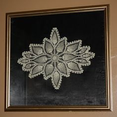 displaying Grandma's crocheted doilies-this would be cool with bright colored yarn and a white frame
