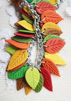 Leaves bracelet, Autumn Bracelet, Leaf bracelet, Fall bracelet, Autumn ewelry, botanical bracelet, fall leaves, leaf jewelry, charm bracelet  WELCOME!  Up for sell handmade autumn bracelet. Made with fully handmade polymer clay leaves and metallic supplies. This item is in stock and ready to ship!  If you love unusual original bijouterie this is for you.  I love my job and invest a piece of this love in each of my works (: Thats why if you are looking for a good gift to yourself, to your…