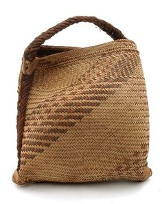 Africa | Woven handled carrier bag from the Chopi people of the Manjacaze region of Mozambique | Vegetable fiber | 20th century