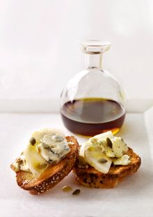 Stilton-Pear Crostini Drizzled with Pumpkin Seed Oil