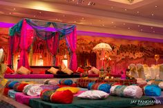 This can be the indian wedding lounge. We could take my futon mattress and cover it with a nice fitted sheet, add festive pillows, and voila!