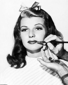 Rita Hayworth gets made up, 1940s. Surely she is getting The Cherry Lip! #NMFallTrends