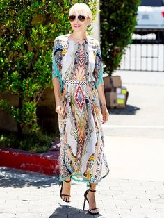 Nicole Richie steps out in a multi-color printed maxi with simple black sandals and sunglasses.