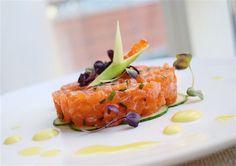 Salmon tartare on dulse seaweed flaked cucumber, topped with scallion, salmon caviar, and yuzu garlic yolk aioli.