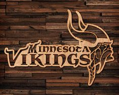 Check out our wood selection for the very best in unique or custom, handmade pieces from our docking stations shops. Hanging Wall Art, Metal Wall Art, Minnesota Vikings Logo, Viking Metal, Scroll Saw, Fall Wreaths, Monster, Woodworking Tips, Art Google