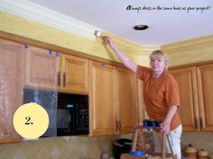 Add crown molding and trim to the sofit to increase height of kitchen and appeal. I would paint all solid white.